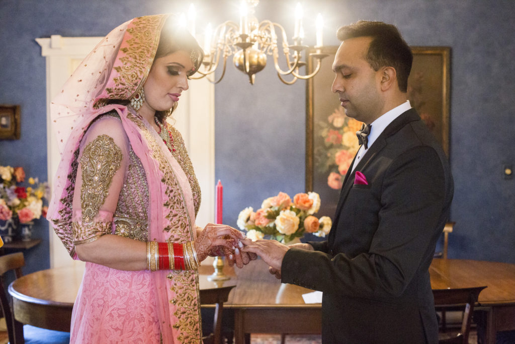 Vancouver wedding couple exchanging rings in Ann Moore's Kitsilano residence