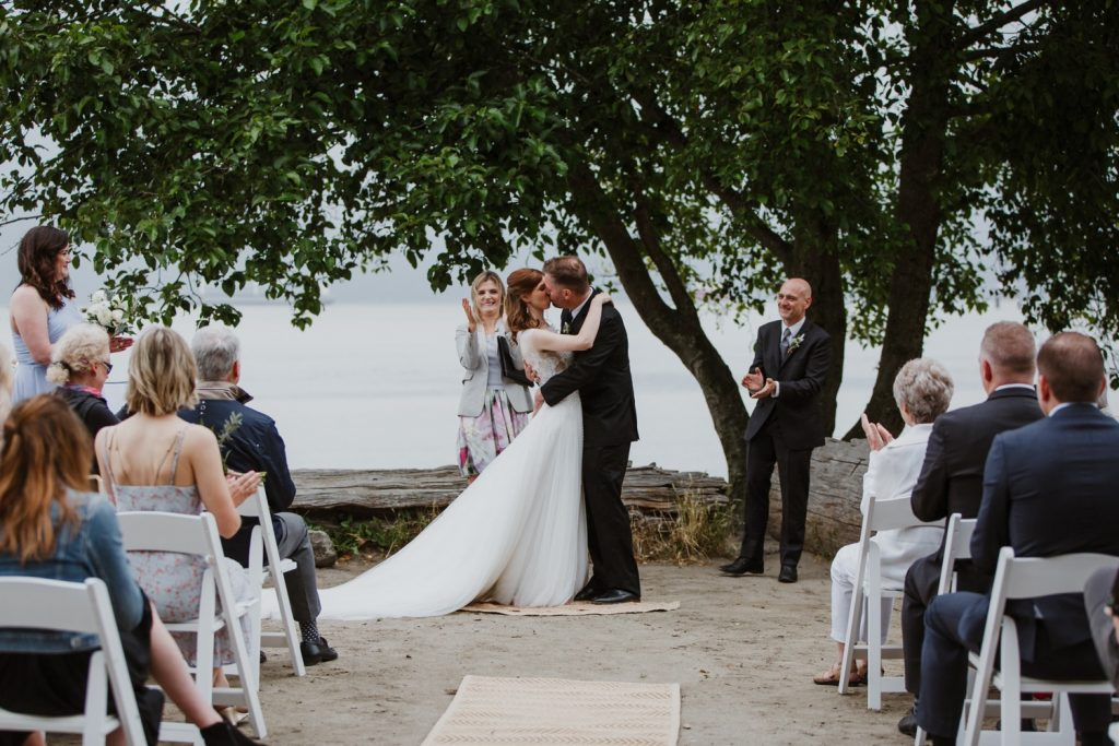 Bride and groom kiss after being announced at husband and wife