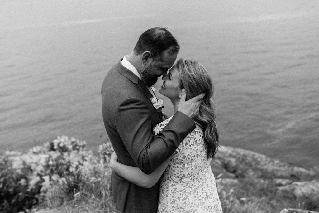 Candid photo of bride and groom looking at each other in whytecliff park