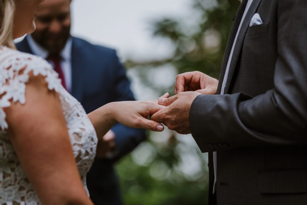 Bride and groom exchanging rings during the elopement ceremony