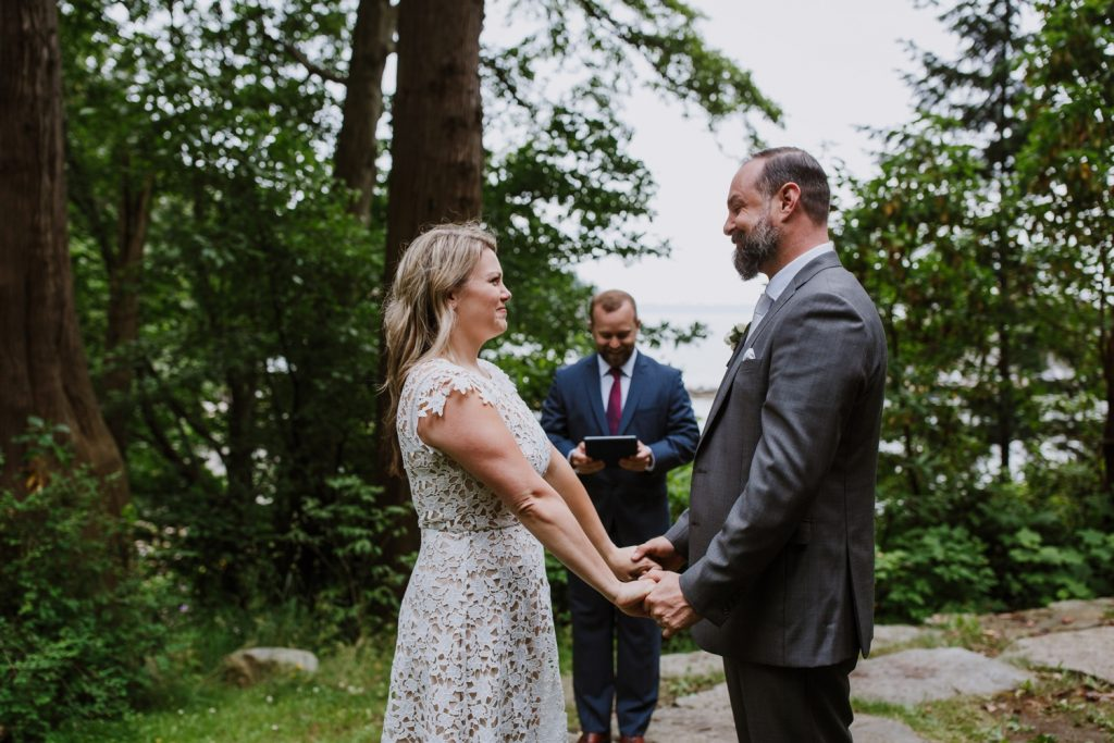 Bride and groom exchanging vows during the elopement ceremony