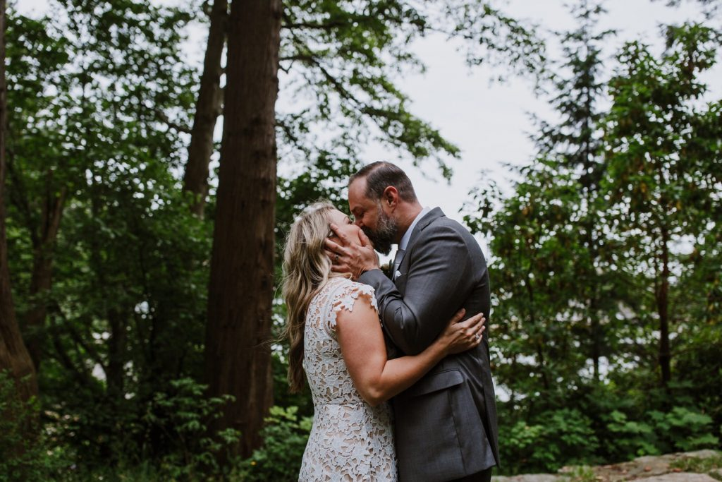Bride and groom's first kiss during the elopement ceremony