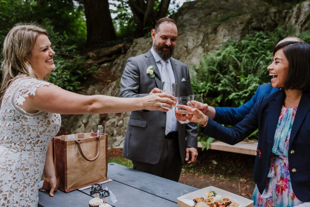 Bride and groom celebrating with a champagne toast with their witnesses after the elopement ceremony